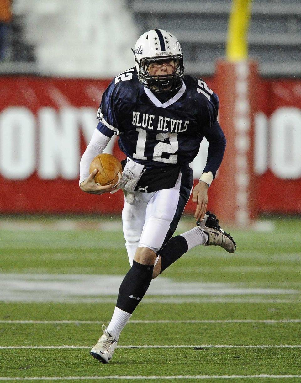 Huntington quarterback Benjamin Kocis runs the football against