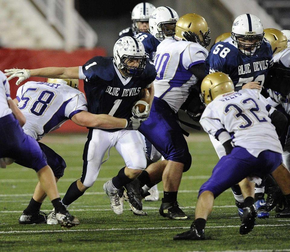 Huntington's Troy Greene drives the football against Sayville