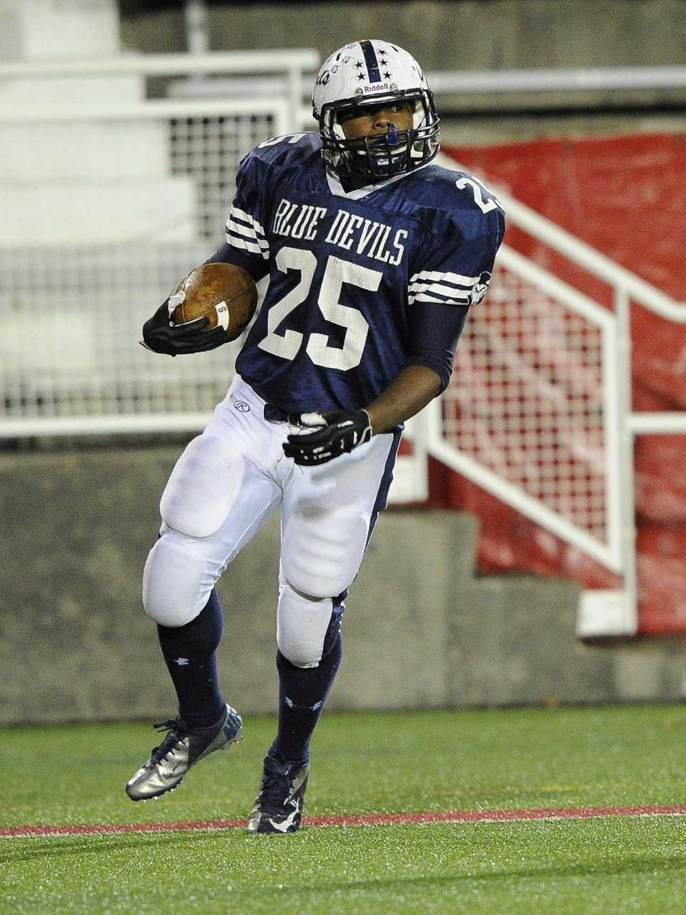 Huntington's Levar Butts looks on after he scores