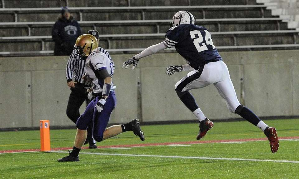 Sayville's Kevin Murphy scores a touchdown ahead of