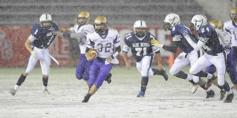 Sayville's Matthew Selts runs the football in the