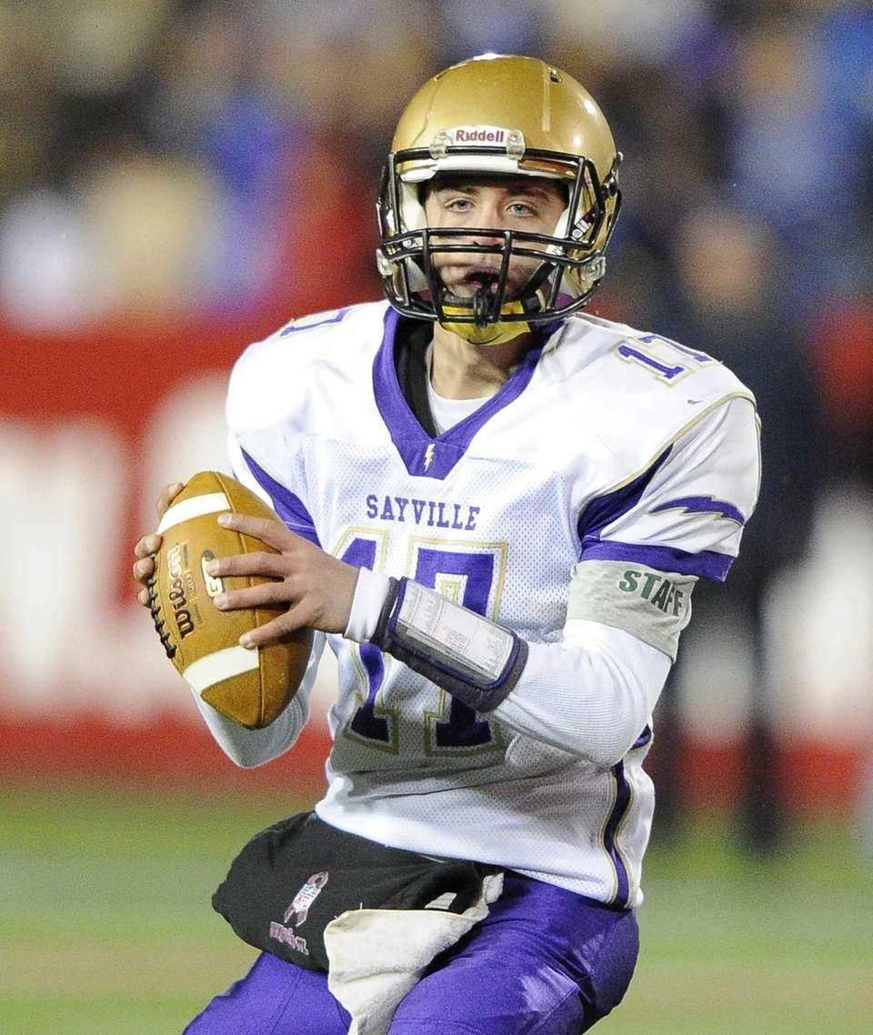 Sayville quarterback Jack Coan looks to pass against