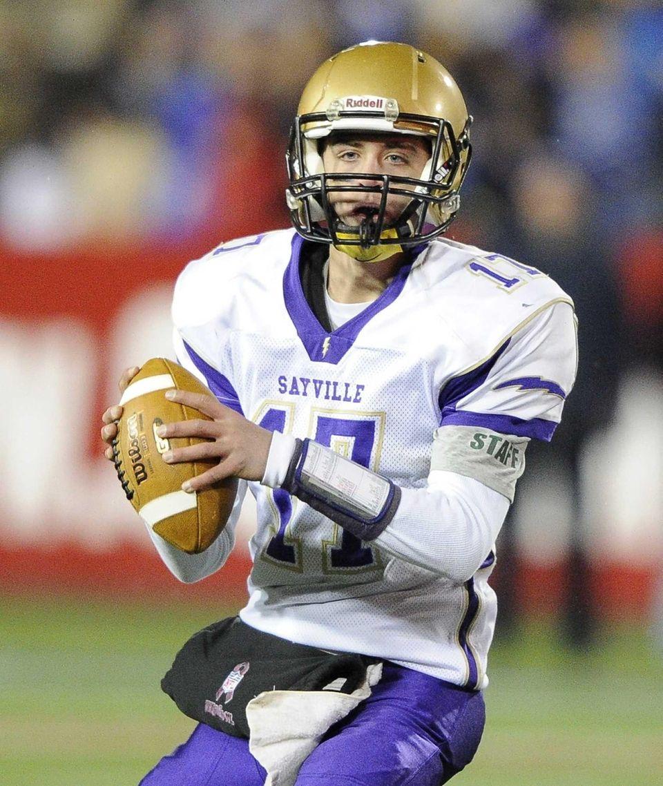Sayville quarterback Jack Coan looks to pass against