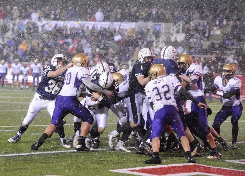 Huntington quarterback Benjamin Kocis rushes for a touchdown