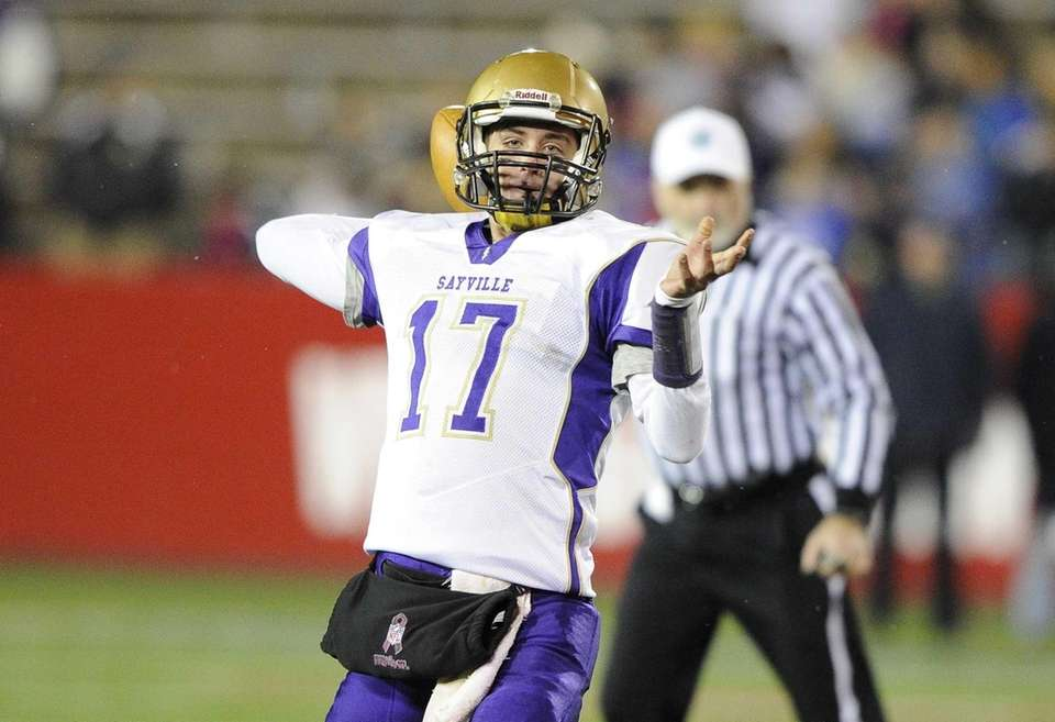 Sayville quarterback Jack Coan passes against Huntington in