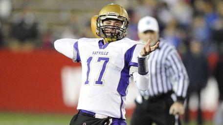 Sayville quarterback Jack Coan passes against Huntington in