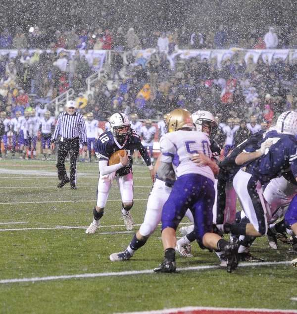 Huntington quarterback Benjamin Kocis runs the football and
