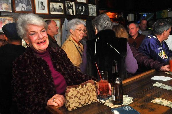 Dolores Ingram, 82, of Long Beach, celebrates at