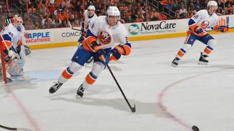 Brock Nelson of the Islanders passes against the