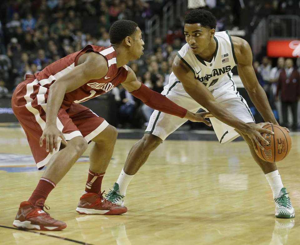 Oklahoma's Isaiah Cousins guards Michigan State's Gary Harris