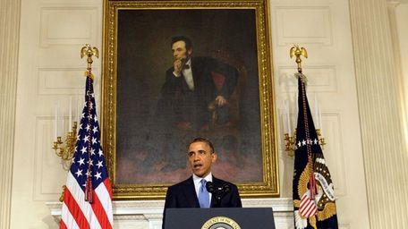 President Barack Obama speaks in the State Dining