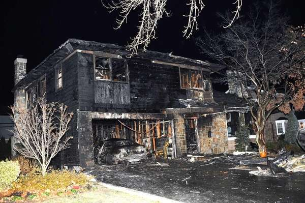 A wind-swept fire gutted an Andover Court home