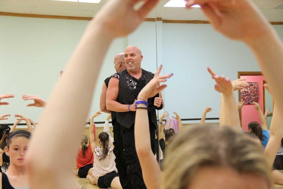 Buddy Casimano, 44, of Merrick, teaches a class