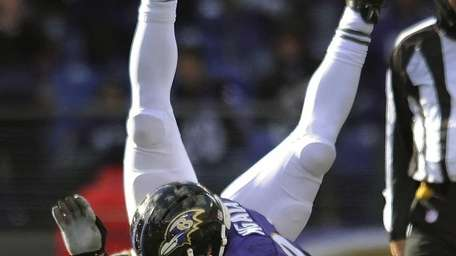Chris Ivory is upended by the Baltimore Ravens'