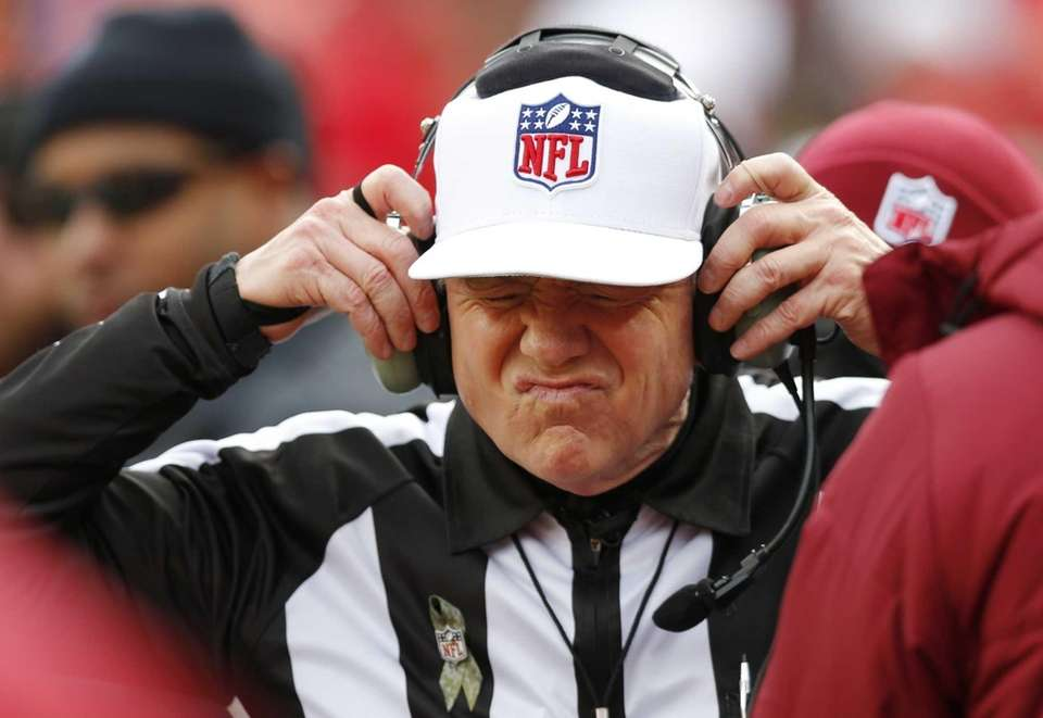 Referee Walt Coleman wears a headset to review