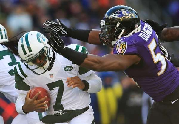 Geno Smith is hit by Baltimore Ravens outside
