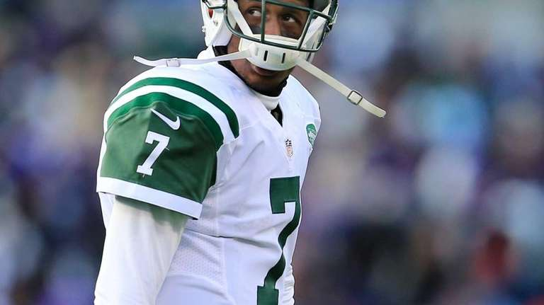 Geno Smith walks off the field after the