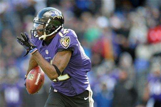 Baltimore Ravens wide receiver Jacoby Jones carries the