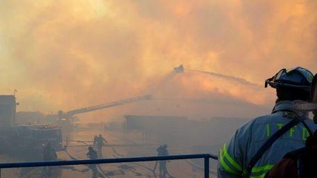 Firefighters battle a blaze on Corbin Ave. in