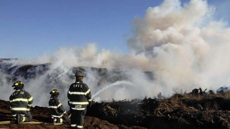 Firefighters from numerous departments battle a fire on