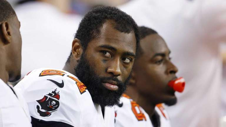 Tampa Bay Buccaneers cornerback Darrelle Revis, center, sits