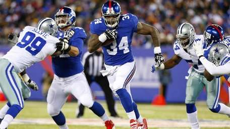 Brandon Jacobs rushes the ball during a game