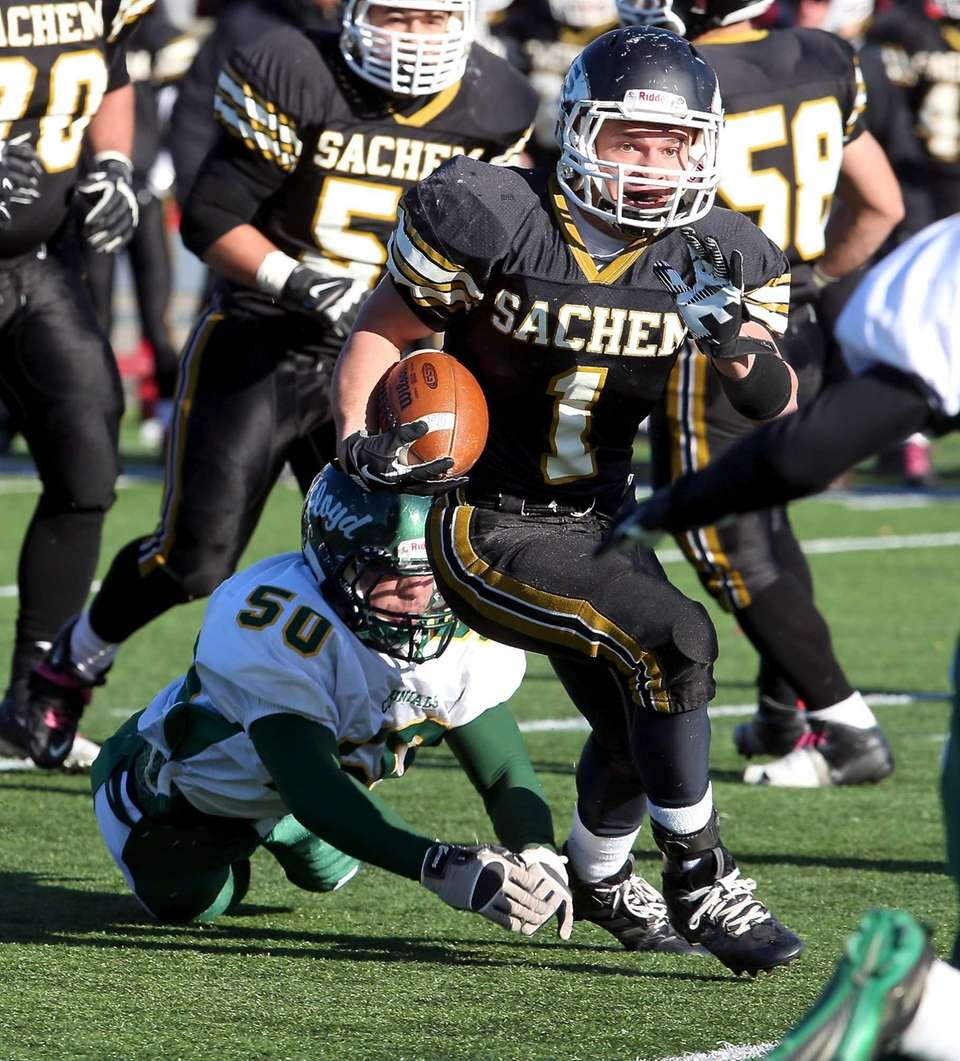 Sachem North running back Trent Crossan (no.1) breaks
