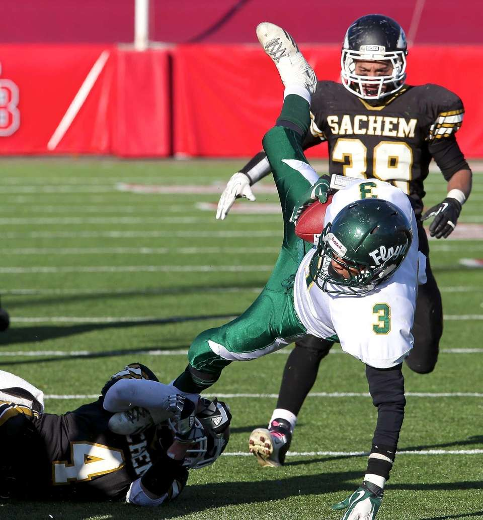 William Floyd's Dwight Corley (no.3) gets upended by