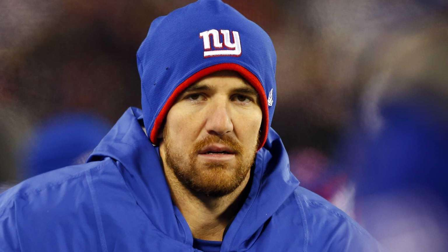 Eli Manning looks on from the bench during