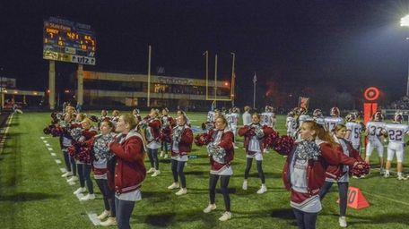 The Garden City High School cheerleading squad gets