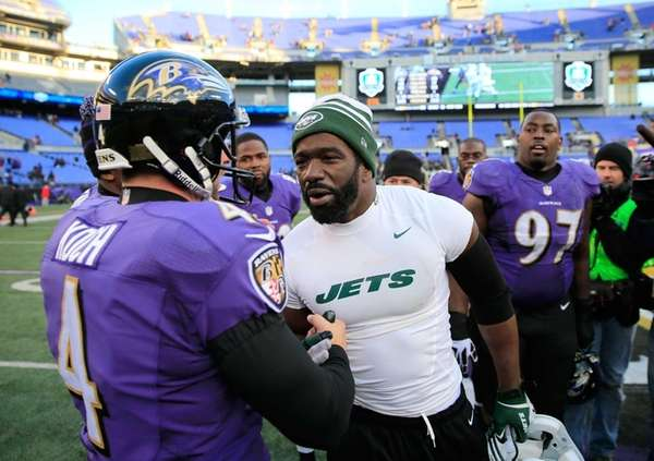 Jets safety Ed Reed (right) talks with Baltimore
