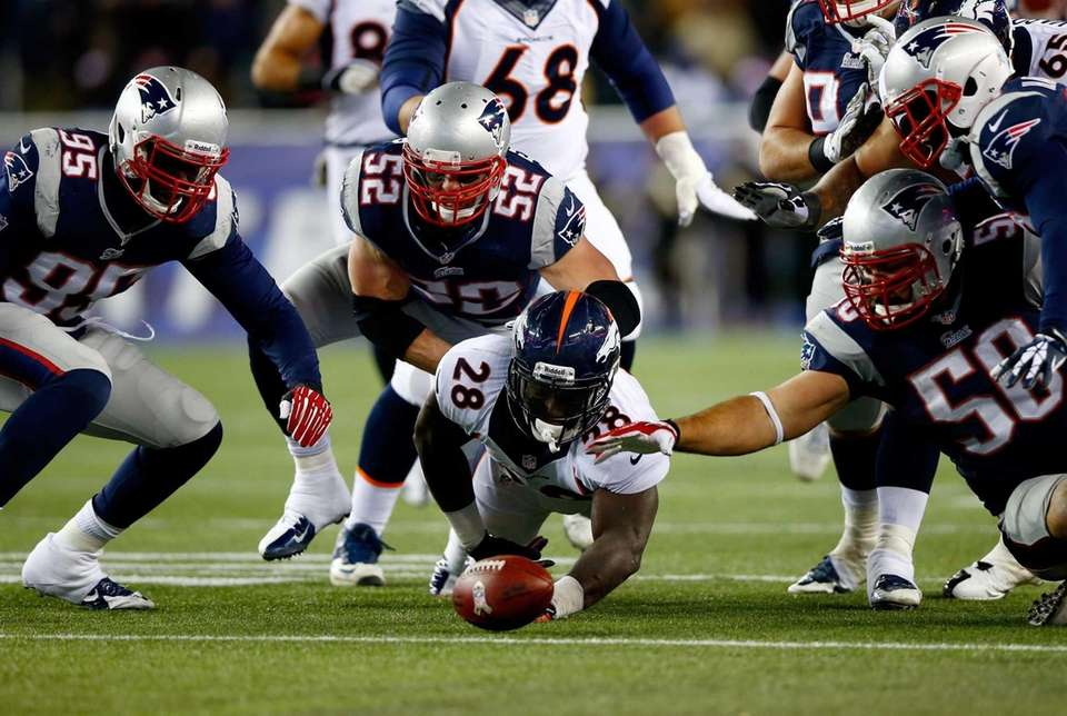 Montee Ball of the Denver Broncos fumbles the
