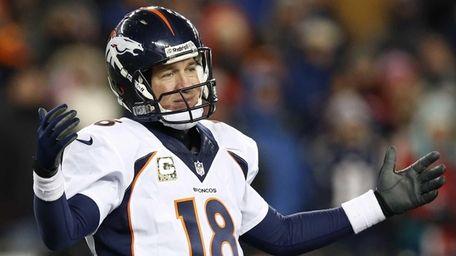 Denver Broncos quarterback Peyton Manning reacts to a