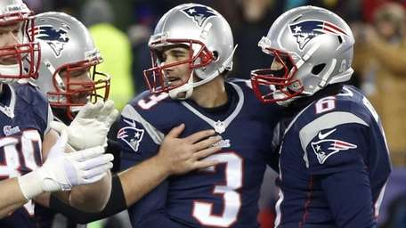 New England Patriots kicker Stephen Gostkowski, center, is