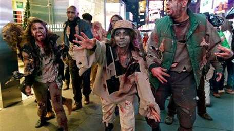 Xbox characters dressed as zombies parade through Times