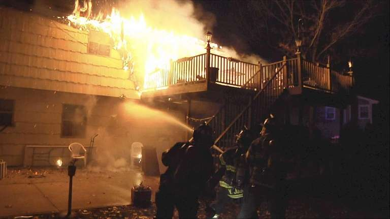 Firefighters from seven departments battled a house fire