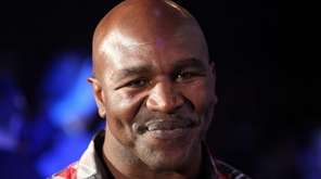 Former boxer Evander Holyfield is present ringside during