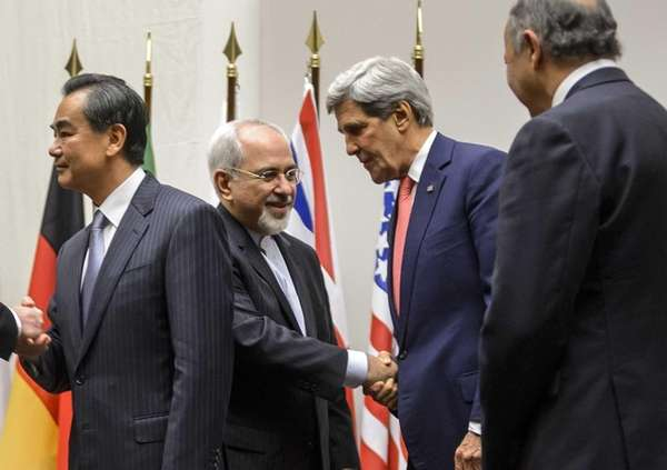 Iranian Foreign Minister Mohammad Javad Zarif shakes hands