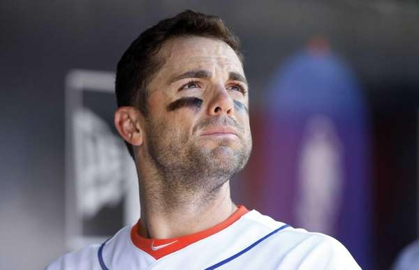 David Wright looks on from the dugout late