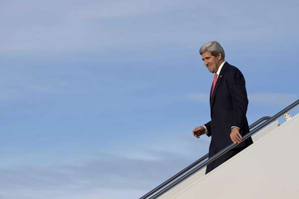 Secretary of State John Kerry steps off of