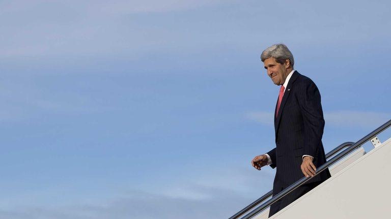 Secretary of State John Kerry steps off of