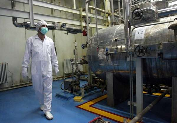 An Iranian technician walks through the Uranium Conversion