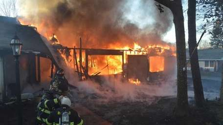 Firefighters battle a fire that destroyed two condos