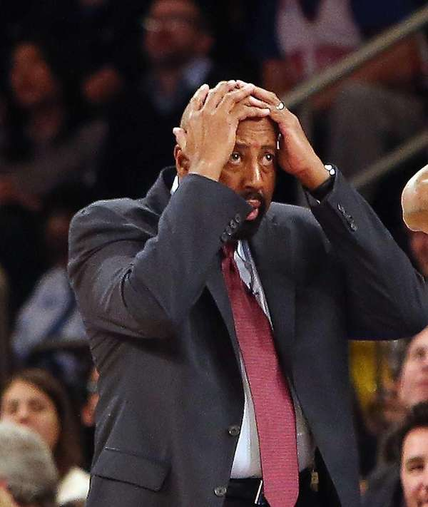 Mike Woodson reacts to a foul call during