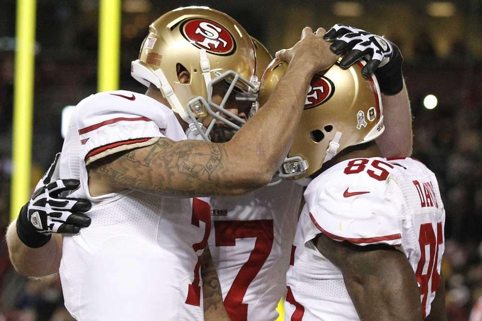 San Francisco 49ers quarterback Colin Kaepernick, left, congratulates