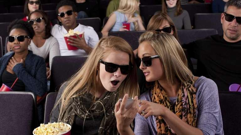 Stock photo of theater goers at a 3-D