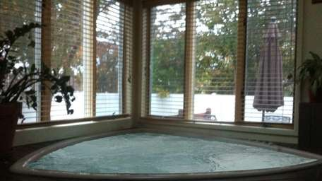 The six-person hot tub in this Merrick home,