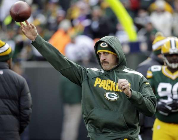 Green Bay Packers quarterback Aaron Rodgers throws before