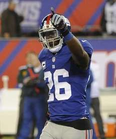 Antrel Rolle reacts in the second half of