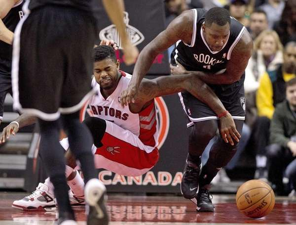 Toronto Raptors forward Amir Johnson, left, and Andray